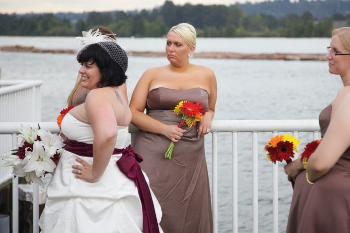 Bride with bridal bouquet and her bridesmaids at a photo shoot on the banks of the Fraser River in New Westminster / Vancouver, Canada