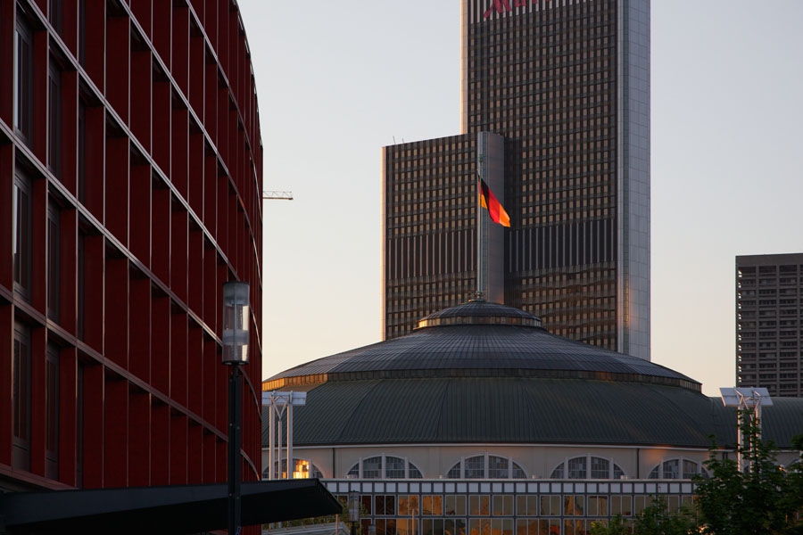 Germany flag on top of the Festhalle in Frankfurt / Main in sunset light